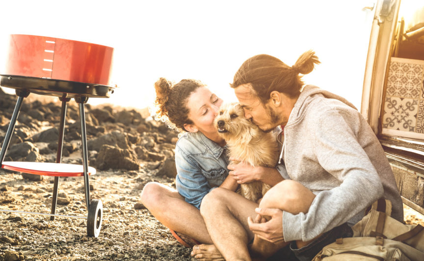 Hipster couple and cute dog relaxing